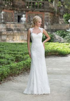 Lace sheath wedding dress with Queen Anne neckline and cap sleeves I Sincerity Bridal I https://www.theknot.com/fashion/3885-sincerity-bridal-wedding-dress