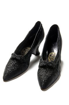 1890, Shoes, Black satin shoes, These elegant shoes have pointed toes, covered French heels and beaded ornamentation across the vamp. They are labeled: Hook, Knowles / & Co. Ltd. / Makers to the / Royal Family; Charleston Museum, / taf