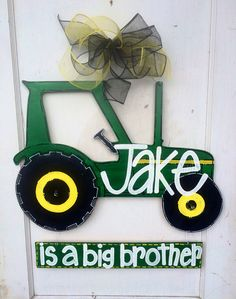 ADORABLE 24 Tractor  This is such a neat idea! This works great for the big brother or sister welcoming a new sibling! Then, the bottom plaque