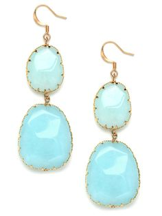 Add a dash of color to prints and solids with stones in a beautiful aquamarine . Set in an intricate gold-tone base, these drops are equal parts feminine and earthy.  Please note that these stones are semi-precious so no two pairs are identical, and small differences in color are expected. BB Spotting: As Seen In InStyle Makeover Edition
