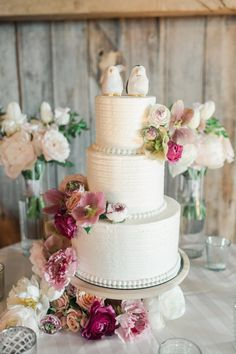 Three tier pearl wrapped penguin topped wedding cake: http://www.stylemepretty.com/2016/12/28/a-wedding-that-fully-embraces-spring/ Photography: Lauren Fair - http://laurenfairphotography.com/