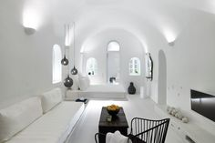 "Architects Ioakeim Patsios and Anastasia Patsiou redesigned this minimal yet luxurious ""Cave"" suite in Oia, Santorini, using white as a dominant color and making references to the interior of the t…"
