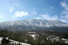 Stunning photo of snow covered mountains in Gatlinburg taken from the Majestic Point Lodge