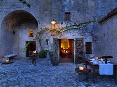Loved sitting here for wine & giant green olives with the beautiful @Steven Trotter Glass Photography   Le Grotte della Civita, Matera,