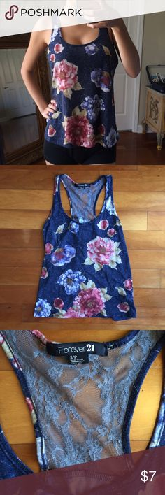 Floral Dark Blue Halter Tank Top || S Floral dark blue halter tank top with gray lace •Condition: minor hole in lace (price reflects)  •Brand: Forever 21 •Size: S  ♡Shipping 1-2 business days✨ ♡Smoke-free closet ♡No trades ♡Make offers using the offer button only (Price will not be negotiated through comments) ♡Bundle! 10% for two or more items!🛍 ♡Comment if you have any questions Forever 21 Tops Tank Tops