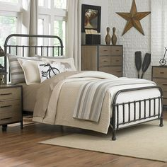 I like the combination of the iron bed, with the white walls, and beige/brown linnen.