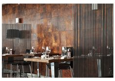 Back wall in restaurant made in leather tiles in random sizes