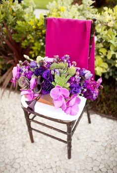 Violet, purple, and pink centerpiece  (Unfortunately it doesn't link back to the post that this came from.  Pretty and the right colors though.)