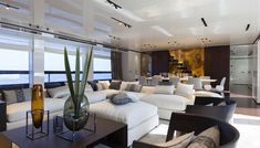 Flexform's Groundpiece sectional sofa, ottoman and hide leather table and Antony small armchairs furnish the sleek Baglietto Yachts 46M Fast.  #yacht #interior #interiordesign #design #yachtdesign