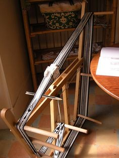 Tablet weaving loom by brigittepicart, via Flickr (looks like an inkle loom doing double duty)