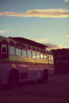 Painted buses and sunset.