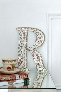 How about making a monogram with broken china plate pieces? This is a great way to use up broken and chipped plates as well.  Be sure to cli...