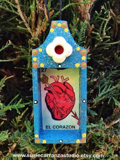 Perfect for not only your holiday decor and gift giving, this miniature piece of art can be displayed year round!  El Corazon mini nicho ornament, $12. Susie Carranza Studio on Etsy.