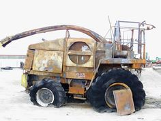 New Holland FX50 harvester salvaged for used parts. This unit is available at All States Ag Parts in Black Creek, WI. Call 877-530-2010 parts. Unit ID#: EQ-24943. The photo depicts the equipment in the condition it arrived at our salvage yard. Parts shown may or may not still be available. http://www.TractorPartsASAP.com
