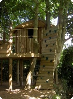 Tree house....love the rock wall!... This would be great at grandmas house!! :)
