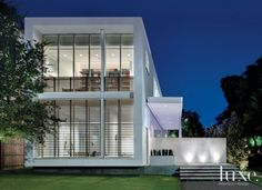 Modern White Exterior with Minimalistic Glass Front