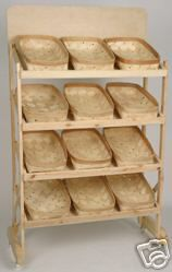 New Wooden Retail Bakers Display Rack w/ 12 Baskets. We need this to keep the girls' toys separated and organized.