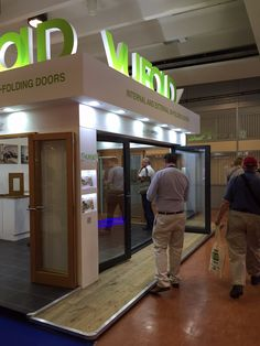 A guest admiring our aluminium Supreme Bifold Door at The Southern Homebuilding & Renovating Show 2015 Folding Doors, Exhibitions, Supreme, Building A House, The Past, Southern, Accordion Doors, Pocket Doors, Build House