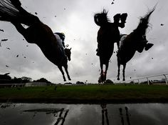 Nick Scholfield riding I'm In Charge (L) clears the water jump on their way to winning The Bathwick Tyres Midsomer Norton Novices' Handicap Steeple Chase at Wincanton racecourse on October 16, 2014 in Wincanton, England. (Photo by Alan Crowhurst/Getty Images)