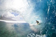 a surfer surfs in Tahiti, French Polynesia