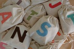 Iron-on initials on muslin favor bags