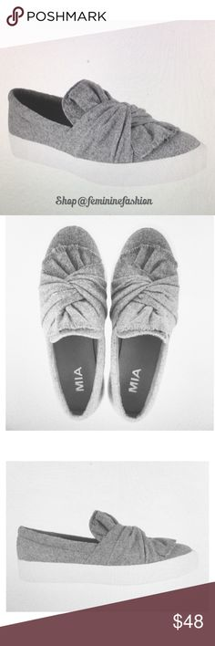 "Mia Gray Slip On Sneaker Mia Zori Gray Slip On Sneaker featuring a large knot and flannel upper.  ""Classic, comfortable, and Chic. Mia says wear the Mia Zoe sneaker with boyfriend jeans and a feminine tee.""  Verbiage credited to Mia. MIA Shoes Sneakers"
