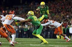 mariota oregon ducks | OR, USA; Oregon Ducks quarterback Marcus Mariota (8) jumps over Oregon ... Heisman Trophy, Oregon Ducks Football, University Of Oregon, Usa Today Sports, Tennessee Titans, College Football, Athlete, Nfl, Soccer