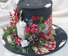 "Use Dollar Store Decos...... Cheap Priced But Not  Cheap Looking..    Yyou Can Make Any Size From Party Favor To Major Table Deco.       Christmas Black ""hat"" Made Of An Old An Old Can And Wooden Circle.  Add Ribbon And Embellish!  Genius!"
