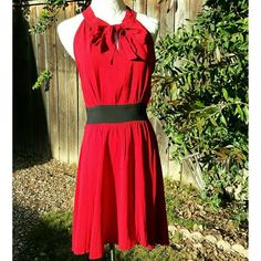 ☆HP☆ NWOT Style Watch Red Dress Rich red dress is instantly intriguing, with a modified ascot halter neckline, racerback cut, and notched neckline, side zipper. Ruching at bust gives way to a thick black waistband and swinging circle skirt is perfect for posing for pictures! Unlined. Length 34.5, bust 36,hip 54, waist 30. 100% Rayon. 40/30/25 HC Lulu's Dresses
