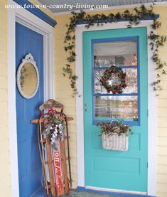 DIY Christmas Decor on my Farmhouse Porch. Vintage sled pairs with greenery. Quick and easy.