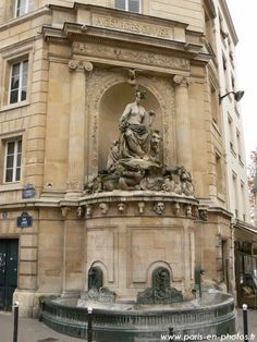 A fauna fountain, near to the Jardin des Plantes, the location of the Museum of Natural Sciences.