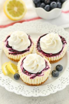 These Mini Lemon Blueberry Cheesecakes feature an easy homemade graham cracker crust, smooth and creamy lemon cheesecake filling, and a simple blueberry swirl! Lemon Blueberry Cheesecake, Mini Cheesecake Recipes, Blueberry Desserts, Cheesecake Bites, Desserts With Blueberries, Simple Cheesecake, Blueberry Topping, Blueberry Sauce, Finger Foods