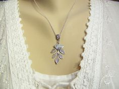 Hey, I found this really awesome Etsy listing at https://www.etsy.com/listing/171626426/bird-branch-necklace-silver-bird-charm