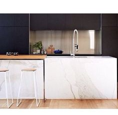 Black + timber + stainless steel + marble kitchen.