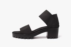 Minimal dual strap dual strap sandal made by hand for James Rowland Shop.  Sporty black elastic upper. Lux suede insole. Thick black rubber lug soles.  2 inch chunk heels.Available in sizes 5-11.