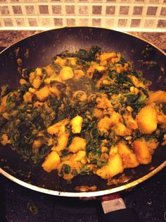 Sag aloo cooking away nicely. Makes part of a fakeaway that can feed a family of four for less than £5 - much cheaper than getting a take out