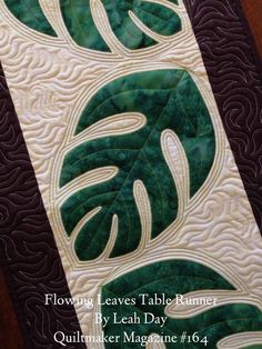 This table runner pattern is very easy with simple piecing and very quick fusible applique leaves. I decided to finish the applique edges with a blanket ...