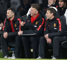 Manager Louis van Gaal of Manchester United has a laugh on the bench