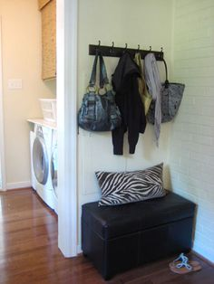 Storage Ottoman + Coat hanging rack = great entryway solution