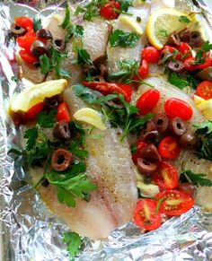Grilled Fish ... Take a shallow baking sheet and wrap the top and bottom with tin foil. Drizzle olive oil on the bottom, and add thinly sliced garlic on the top. Place your fish fillets over the sliced garlic, tilapia is used here.