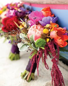 Multicolored, mixed flower bouquet, a perfect pop against white wedding gown. Use a single deeper color for your wedding theme to pull off this bouquet