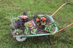 A used wheelbarrow with a picture from Good Will works really nice in the middle of the lawn. Everyday Items, Wheelbarrow, Really Cool Stuff, Garden Tools, Lawn, Photos, Pictures, Middle, Make It Yourself