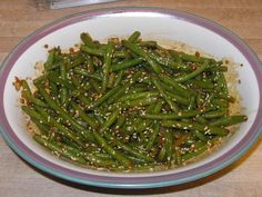Made with canola oil, green beans, onion, hoisin sauce, soy sauce, sesame oil, water, garlic, fresh ginger, sugar, red pepper flakes, sesame seeds | CDKitchen.com