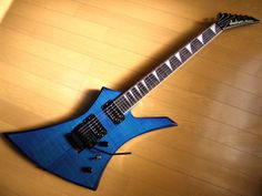 Blue Jackson Kelly FR- This is my newest guitar. It sounds killer and plays great, but it is neck heavy (Very neck heavy) I am working on fixing the neck heavy issue...
