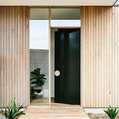Bold and striking Timber Round Pull Handle installed at the entrance door of the amazing beach house by Photography by… Front Door Design, Front Door Colors, House Entrance, Entrance Doors, Entrance Ideas, Main Entrance, Timber Garage Door, External Front Doors, Unique Front Doors