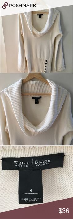 """WHBM ivory cowl neck on/off shoulder sweater Gorgeous ivory sweater from WHBM. Wide rib trim along the bottom and cuffs with button detail on one side of the hem. This can be worn as a cowl neck or off the shoulder. Perfect for the upcoming holidays! Sz small. Approx 17"""" flat across the bust, 29"""" shoulder to hem. B1* White House Black Market Sweaters Cowl & Turtlenecks"""