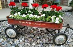 gardening ideas planter vintage wagon fall ideas rustic, container gardening, repurposing upcycling, Early plantings in my little red wagon - Gardening For Life Flower Planters, Garden Planters, Garden Art, Flower Containers, Garden Deco, Dream Garden, Wagon Planter, Kids Wagon, Spiral Garden