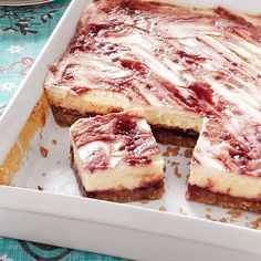 Raspberry Cheesecake Bars Recipe -My family's love of raspberries and cheesecake make this a perfect dessert for us. The luscious treat is best eaten with a fork.—Jill Cox, Lincoln, Nebraska