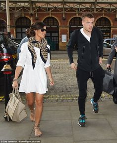 Dressed to impress:The 33-year-old WAG stepped out ahead of her footballer fiance and loo...