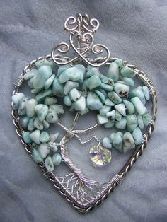 Larimar HeartShaped Tree of Life Wire by RachaelsWireGarden. I wish I could buy this, but it is already sold.